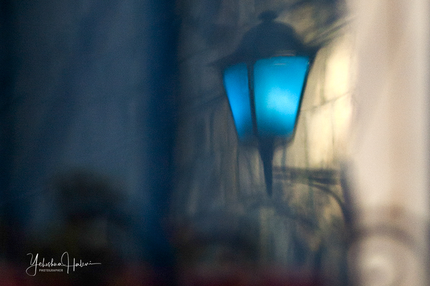A blue street lamp in the Old City of Tzfat in this Israel the Beautiful blog post