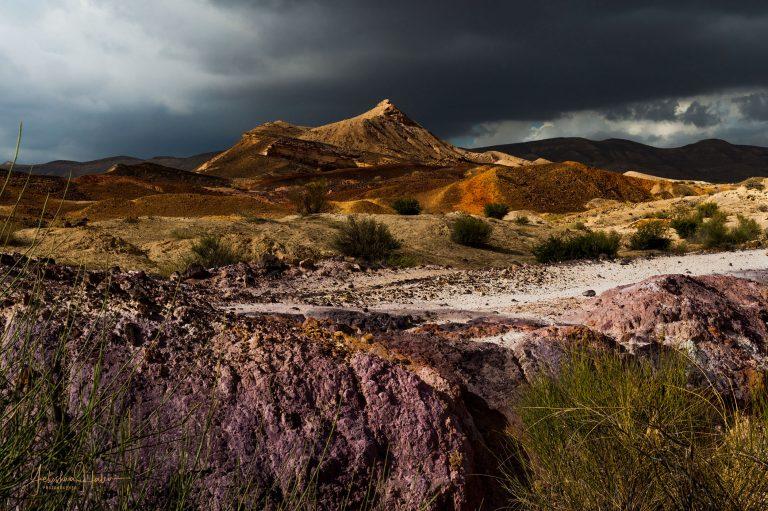 Rocky mountain peak and purple rocks in Israel's Negev Desert